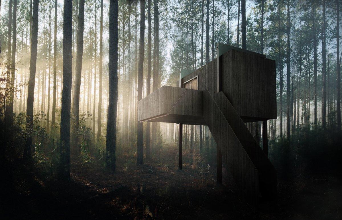 zwart houten boomhut in een bos